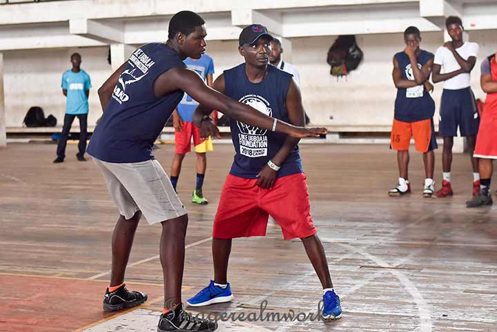 A coach instructing the boys during the Ejike Ugboaja Summer camp 2018